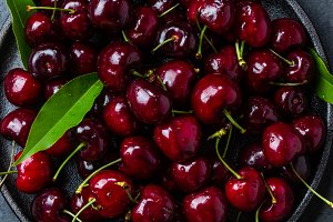 Fresh cherry with leaves. Background top view