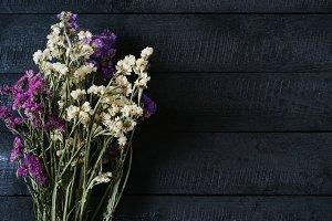 Bouquet on wood background. Mockup