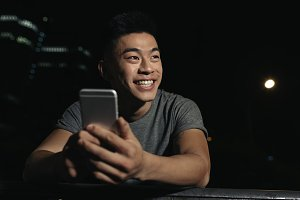 Asian young man using his mobile.