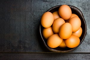 Fresh eggs on black background