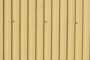 Tan metal siding background