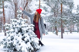 Hipster Girl and tree in winter.