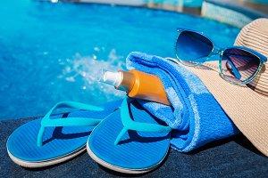 slippers sunscreen cream towel hat sunglasses