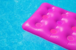 air mattress pool holiday tropical concept