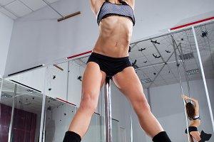 woman dancing around the pole