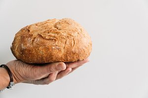 Woman hand holding a loaf