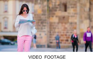 Travel tourist woman with map Prague