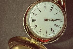 Antique pocket watch in case
