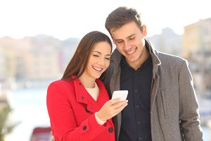 Couple sharing a smart phone