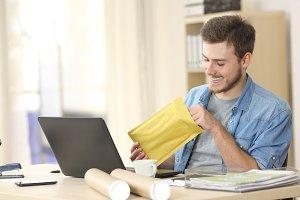 Entrepreneur opening envelope