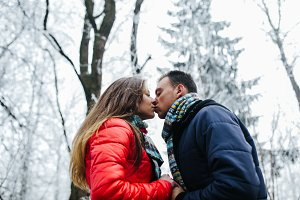Kiss in the winter forest