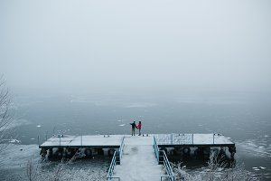 beautiful young couple standing on a pier