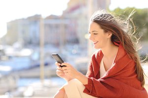 Girl sitting using a smart phone