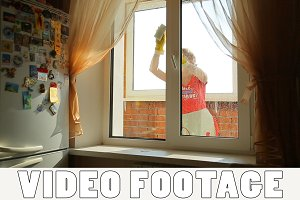 Girl washes the window