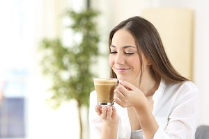 Happy woman enjoying a coffee