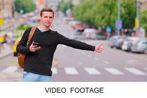 Young man catch taxi european street