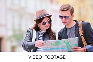 Happy tourist couple with city map