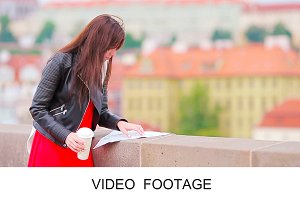 Travel girl with map Prague outdoors
