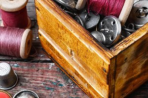 set of threads and buttons