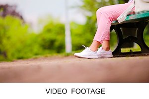 Girl listening music dancing legs