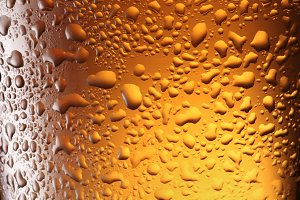 Close up shot of frosty beer glass.