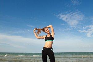 Woman in sports wear posing