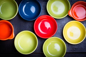 Different colorful bowl on black background