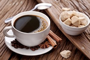 Cup of coffee with sugar cubes