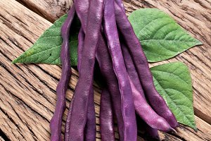 Violet beans on the old wood