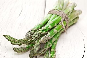 Bunch of asparagus on a wood