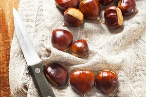 fresh chestnuts on a linen napkin