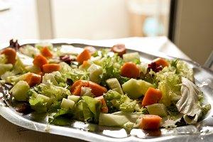 Salad varied on a metal tray.