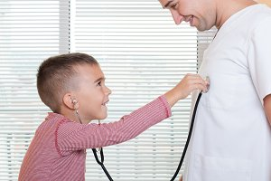 Patient child plays with doctor