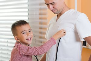child listen to doctor's heart