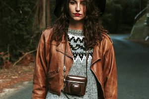 modern young woman with vintage camera photos