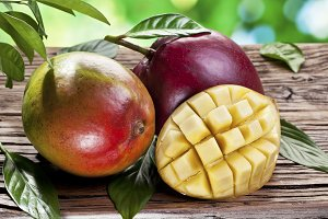 Mango fruits on a wooden table