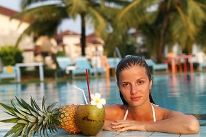 woman in pool with coconut