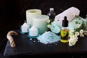 Spa set with candles, selective focus, space for text