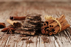pieces of chocolate with cinnamon and anise stars