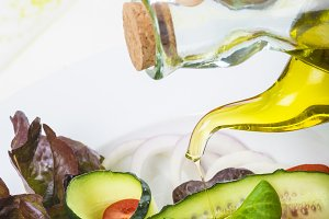 Dressing a gourmet salad with olive oil