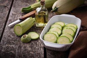 Sliced zucchini in baking dish