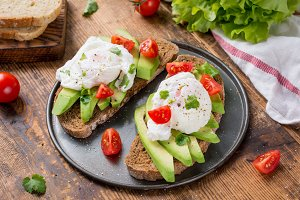 Avocado, poached egg, tomato toasts