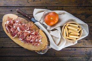 Serrano ham and breadsticks appetizer
