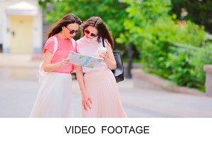 Two girls shopping walking street