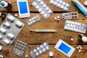 antibiotics on a wooden background
