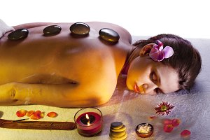 woman getting stone massage