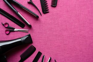 barber tools on a pink background