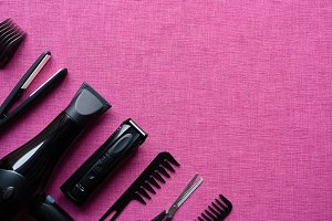 barber tools on pink background