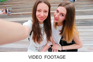 Tourist friends girls making selfie