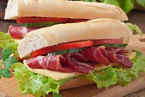 Big sandwich with raw smoked meat